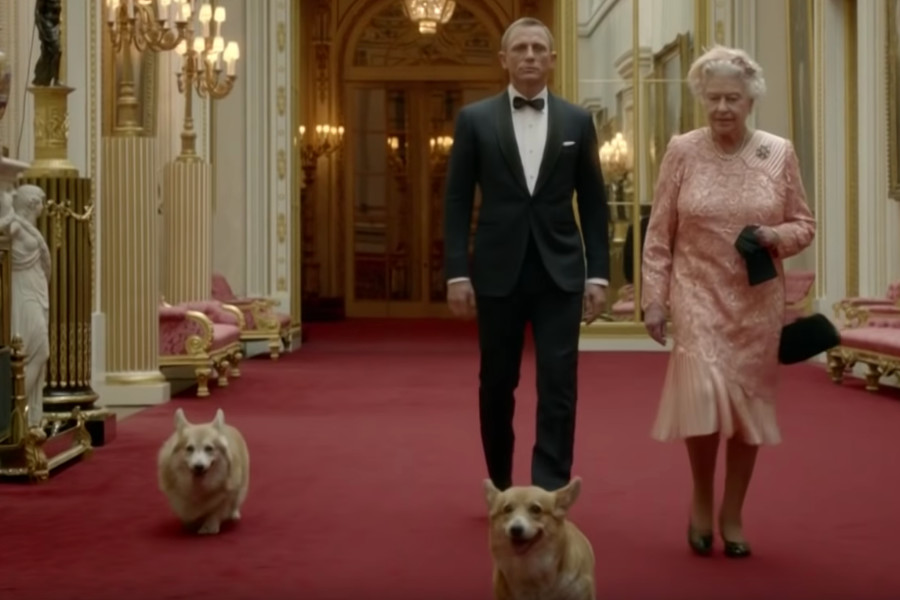 Queen Elizabeth and her two Corgis star alongside actor Daniel Craig Credit: Screen grab
